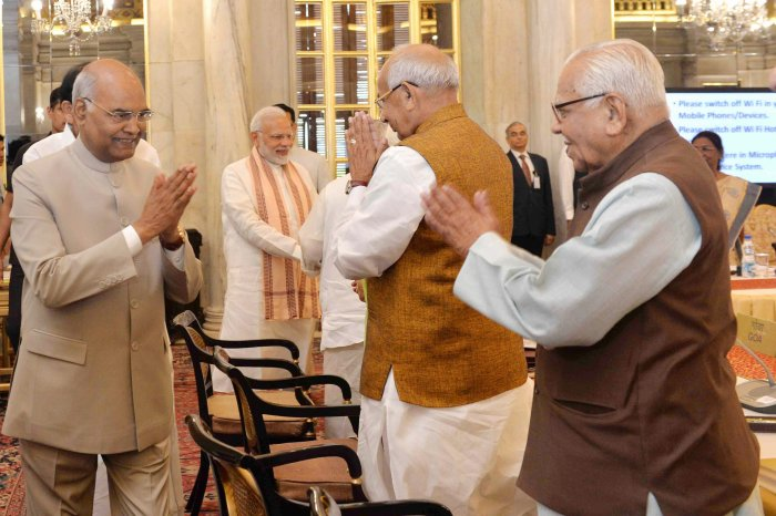 President Ram Nath Kovind exchanges greetings with Governors Kaptan Singh Solanki and Ram Naik at the Conference of Governors at Rashtrapati Bhavan, in New Delhi on Monday. PTI