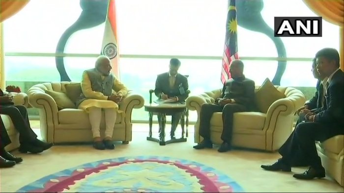 Prime Minister Modi meets Malaysian Prime Minister Mahathir Bin Mohamad in Kuala Lumpur. (ANI Photo)