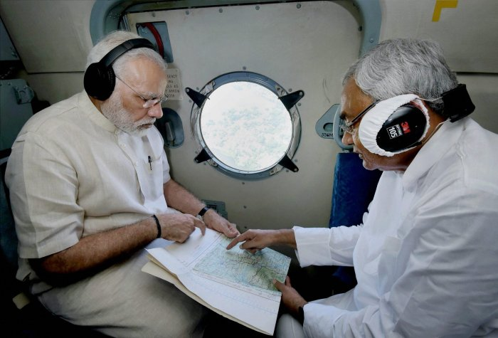 Prime Minister Narendra Modi with Chief Minister of Bihar Nitish Kumar conducting an aerial survey of flood affected areas, in Bihar. PTI file photo