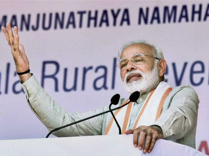 """""""The social security schemes of the Government of India will help people cope with the uncertainties of life,"""" Modi said. (PTI file photo)"""