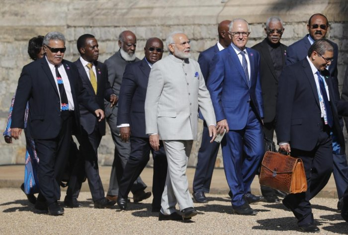 Australian Prime Minister Malcolm Turnbull, centre right, talks to the Indian Prime Minister Narendra Modi, centre left, as they arrive for the the second day of the Commonwealth Heads of Government 2018 for a behind closed doors meeting in Windsor, England, Friday, April 20, 2018. Leaders from the 53-nation Commonwealth nations are meeting in Windsor Castle Friday, without official agenda but are widely expected to discuss protecting the world's oceans, cybersecurity and who should become the next leader o