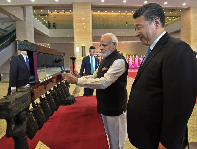 Prime Minister Narendra Modi with Chinese President Xi Jinping visit an exhibition at Hubei Provincial Museum, in Wuhan, China on Friday. PTI Photo / PIB