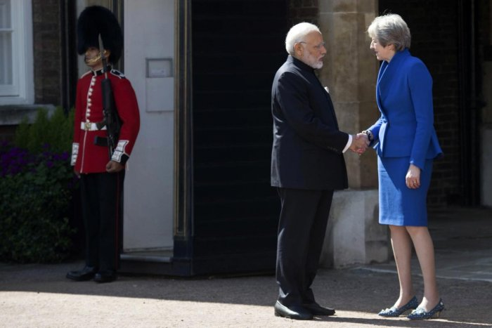 Britain's Prime Minister Theresa May greets Indian Prime Minister Narendra Modi at the official welcome ceremony for the Commonwealth Heads of Government Meeting at Friary Court in St James's Palace, London, Thursday April 19, 2018. AP/PTI