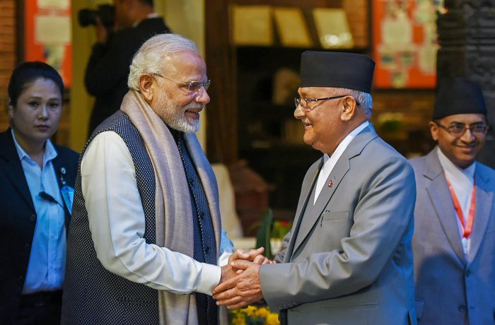 Prime Minister Narendra Modi shakes hands with his Nepali counterpart KP Sharma Oli ahead of delegation level talks in Kathmandu on Friday. PTI