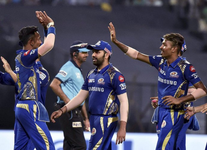 WATCH THEM OUT: The Pandya brothers -- Hardik (right) and Krunal -- will be looking to continue their good run and power Mumbai Indians to the play-offs. AFP