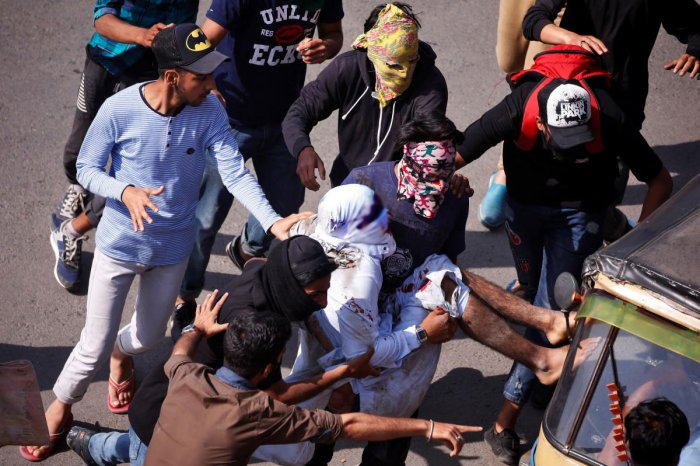 Protesters carry an injured man who according to local media was hit by a Central Reserve Police Force (CRPF) vehicle during a protest after Friday prayers. Reuters photo.
