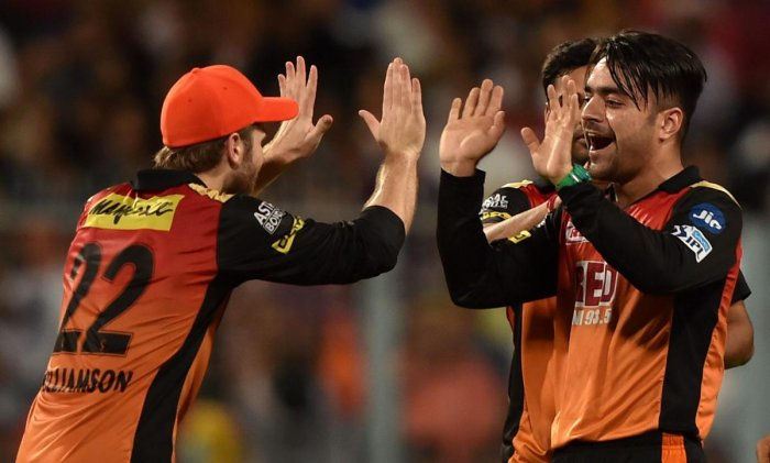 SRH bowler Rashid Khan jubiliates with his captain Kane Williamson after dismissed KKR batsman C.Lynn(unseen) during IPL-2018 Qualifier-2 Match at Eden Garden in Kolkata on Friday. PTI