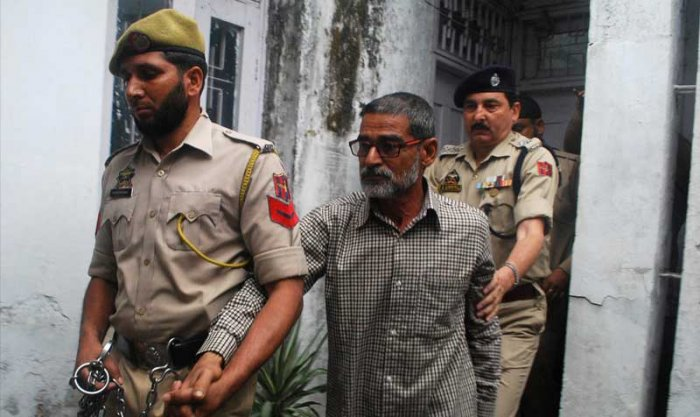 Sanji Ram arrives for a court appearance after he was arrested in connection with the rape and murder of an eight-year-old girl in Kathua, south of Jammu, April 16, 2018. REUTERS/Stringer