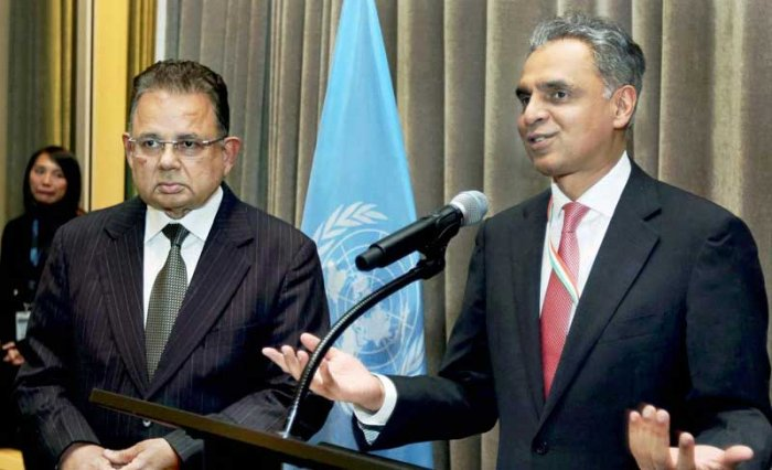 India's Permanent Representative to the United Nations Syed Akbaruddin speaks during a reception in the honour of Justice Dalveer Bhandari (L) at the United Nations in New York on Monday. India's Dalveer Bhandari won the votes in the UN General Assembly to make it to the International Court of Justice after UK pulled out the race. PTI Photo