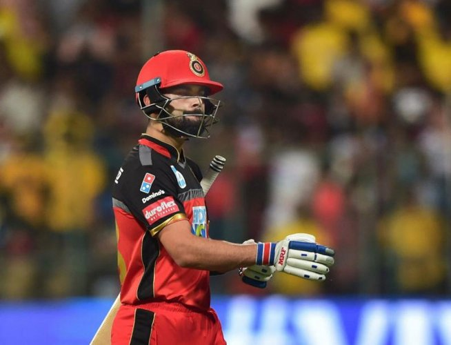 Kohli faces a fine of Rs 12 lakh for slow-bowling in the match against CSK. PTI photo.