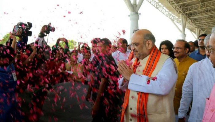 Amit Shah, BJP national president, being showered with rose petals on his arrival to address party workers in Raipur.