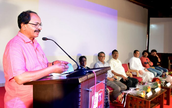 Karnataka Chalanachitra Academy Chairman Nagathihalli Chandrashekhar speaks after inaugurating a regional language film festival at St Aloysius College in Mangaluru on Friday. Principal Fr Pravin Martis, filmmaker Richard Castelino, film festival convener