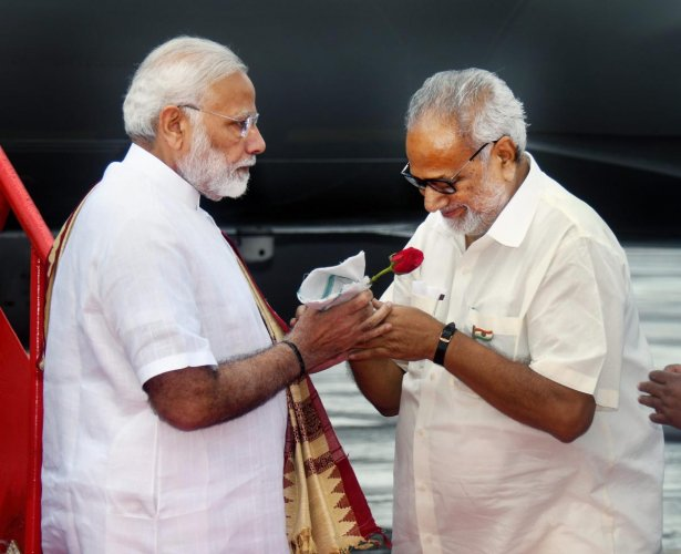 Prime Minister Narendra Modi is received by Governor Ganeshi Lal on his arrival at the Bhubaneswar airport, Saturday, Sep 22, 2018. (PTI Photo)