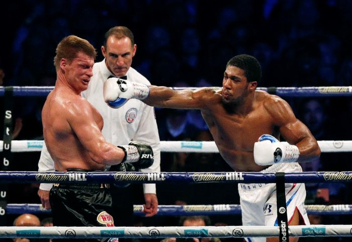 TAKE THAT Russia's Alexander Povetkin knocked down to the canvas as Britain's Anthony Joshua lands a punch during their boxing world heavyweight title fight in London on Saturday. AFP