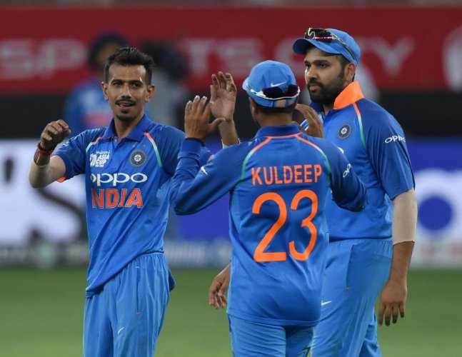 GOT HIM: India's Yuzvendra Chahal (left) celebrates with team-mates after dismissing Pakistan's Asif Ali in Dubai on Sunday. AFP