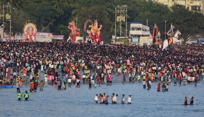 People crowd during the Ganesha immersion at Girgaum chowpatty in Mumbai. DH Photo