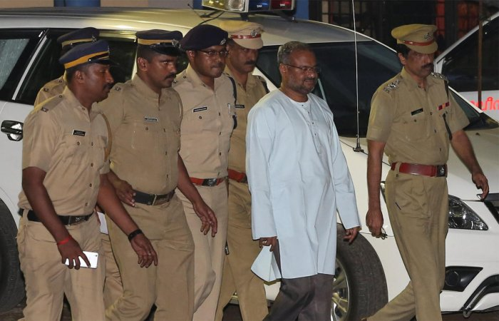 Franco Mulakkal (2nd R), accused of raping a nun, is escorted by police outside a crime branch office on the outskirts of Kochi in the southern state of Kerala. Reuters file photo.
