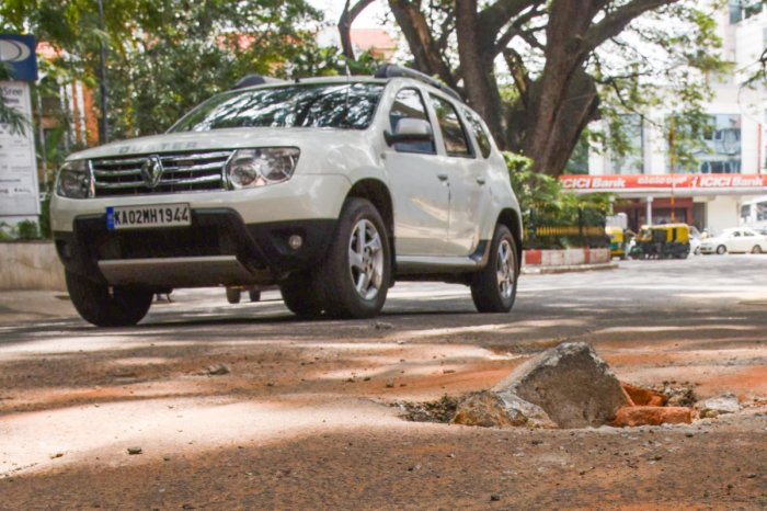 Pothole seen in front of Global Tech Park, Cornwell cross and O Shaughnessy road junction, Langford town in Bengaluru on Sunday. Photo by S K Dinesh