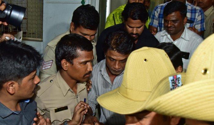 'Duniya' Vijay after his arrest. DH Photo