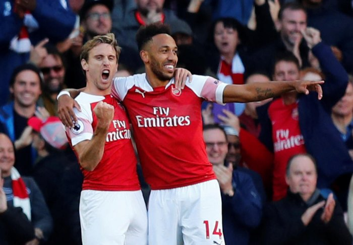 LUCKY STRIKE: Arsenal's Pierre-Emerick Aubameyang (right) celebrates with Nacho Monreal after scoring against Everton on Sunday. REUTERS