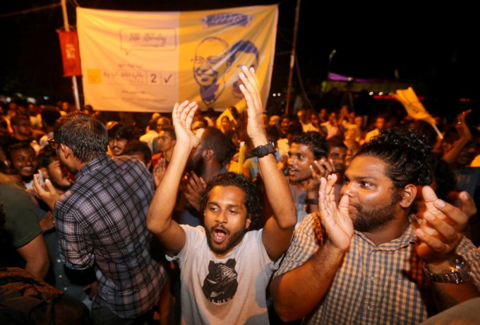 Supporters of Maldivian joint-opposition presidential candidate Ibrahim Mohamed Solih celebrate on the street at the end of the presidential election day in Male, Maldives September 24, 2018. REUTERS/Ashwa Faheem.