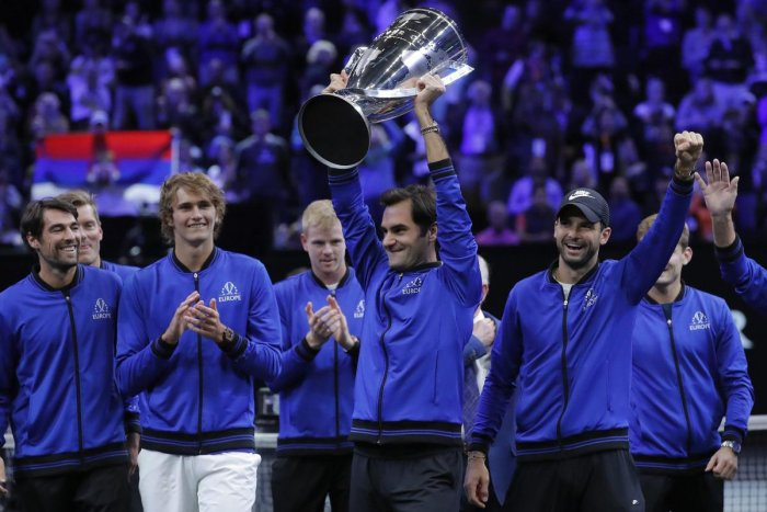 CHAMPS: Team Europe's Roger Federer hoists the Laver Cup as his team-mates celebrate after their win over Team World in the Laver Cup. AFP/PTI
