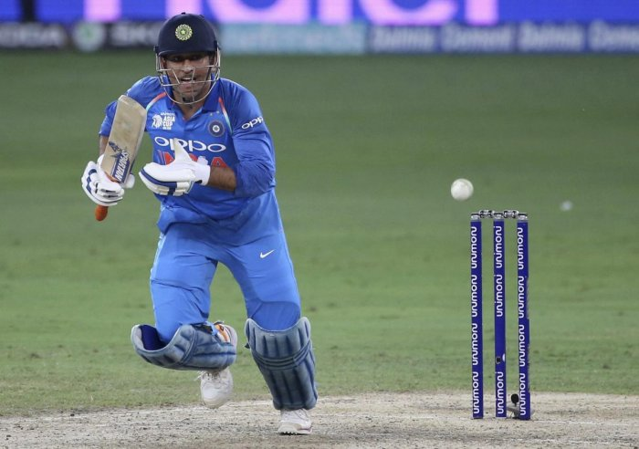 TRYING TIMES M S Dhoni, who hasn't spent much time in the middle, may get an early hit against Afghanistan. AFP