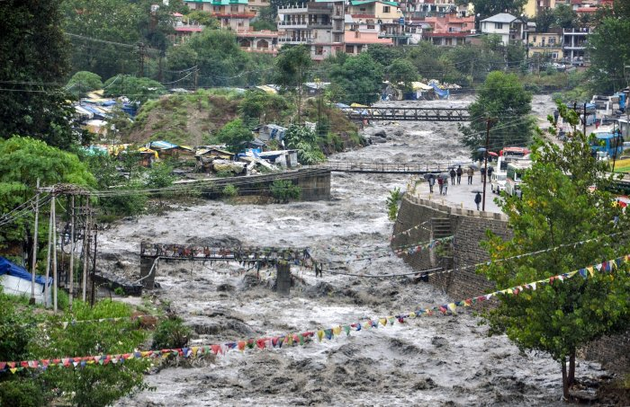 A swollen Beas river flows after heavy rains in the region, in Kullu district, Monday. PTI