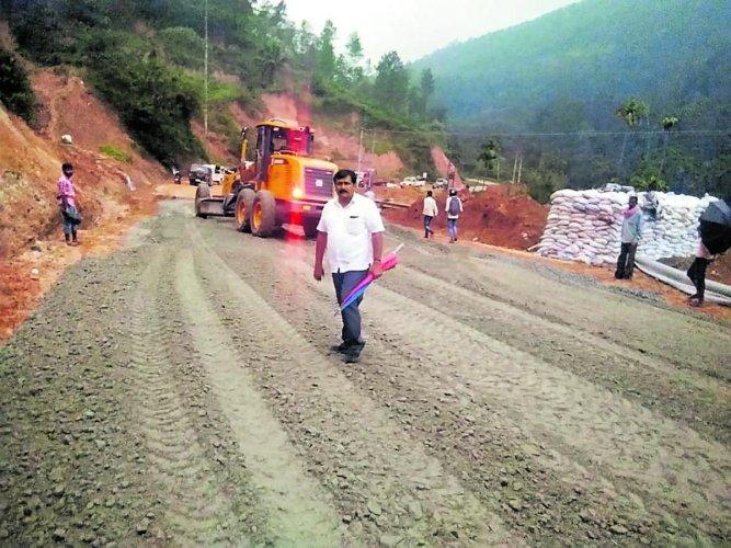 The work on Sampaje Ghat road in progress.