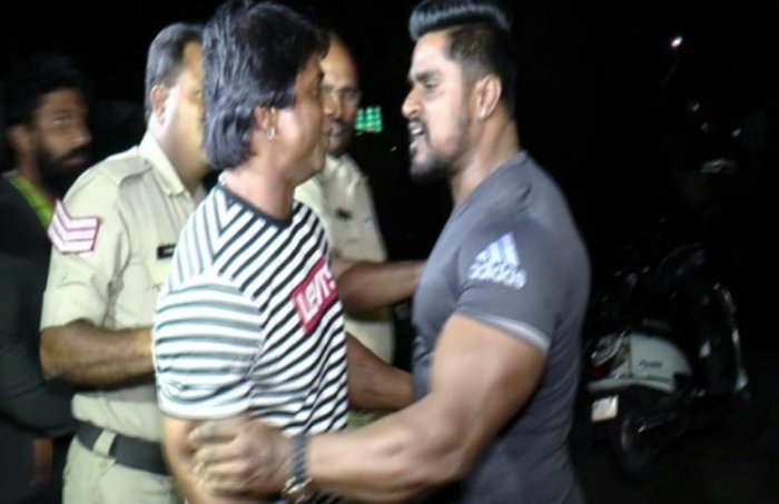The altercation between Duniya Vijay and Kitty at the High Ground police station in the presence of officials.