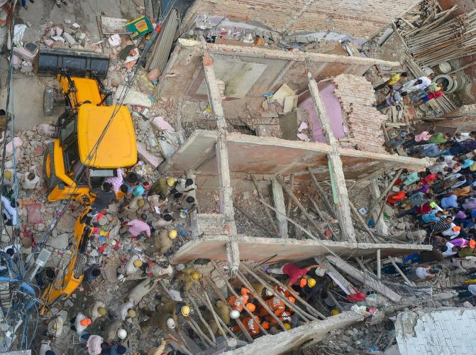 Rescue workers carry out the operation after a three-storey building collapsed at Ashok Vihar in northwest Delhi on Wednesday. (PTI file photo)