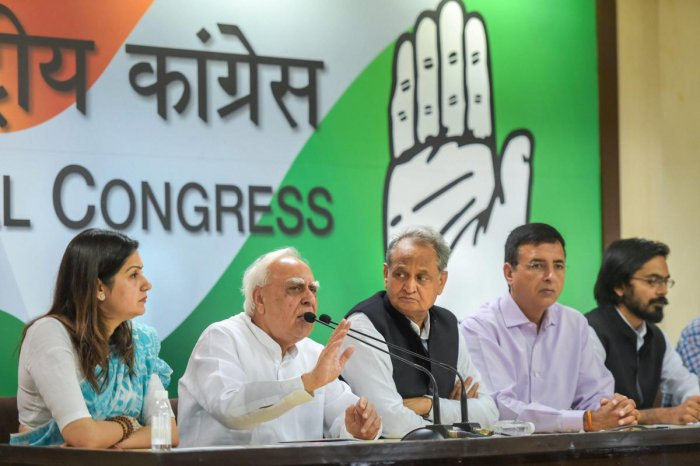 Congress leader Kapil Sibal speaks as Ashok Gehlot, Randeep Singh Surjewala and others look on during a press conference at AICC, in New Delhi, on Wednesday. (PTI Photo)