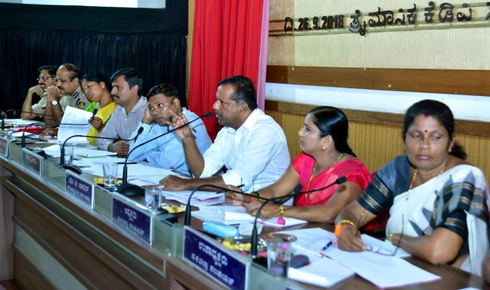 Urban Development and Housing Minister U T Khader speaks at the KDP meeting at ZP Hall in Mangaluru on Wednesday. SP Ravikanthe Gowda, Police Commissioner T R Suresh, ZP CEO Selvamani R, Deputy Commissioner Sasikanth Senthil, ZP President Meenakshi Shanth