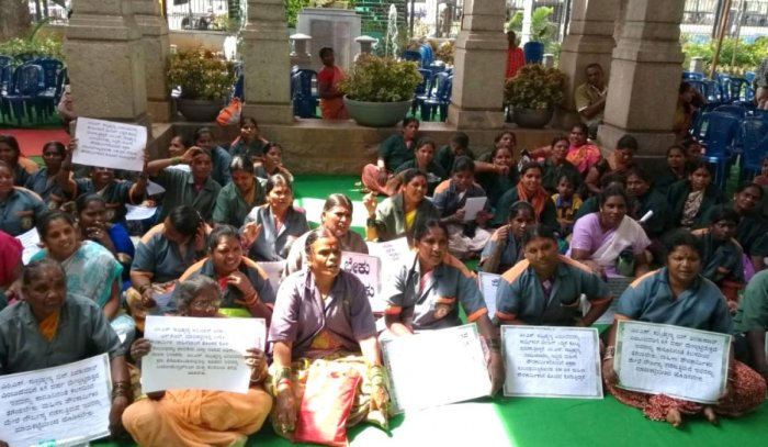 Civic workers of KR Market area stage a protest over the delay in remitance of their salary infront of the BBMP headquarters on Wednesday.