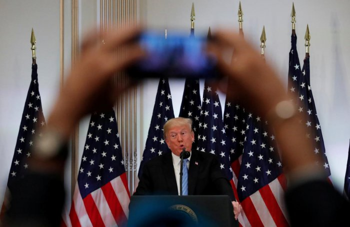 A reporter uses his mobile phone to record U.S. President Donald Trump at a news conference on the sidelines of the 73rd session of the United Nations General Assembly in New York, U.S., September 26, 2018. Reuters