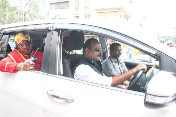 Mayor R Sampath Raj drives his crew for lunch to MTR Restaurant on Wednesday.