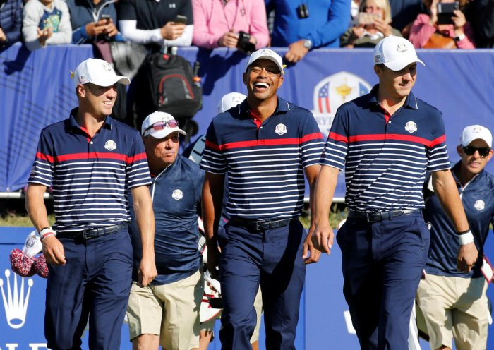 CALM BEFORE STORM: Team USA's (from left) Justin Thomas, Tiger Woods and Jordan Spieth share a joke during a practice session at the Le Golf National. REUTERS