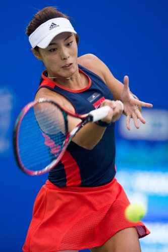 Wang Qiang of China returns against Monica Puig of Puerto Rico during their quarterfinal at the WTA Wuhan Open on Thursday. AFP