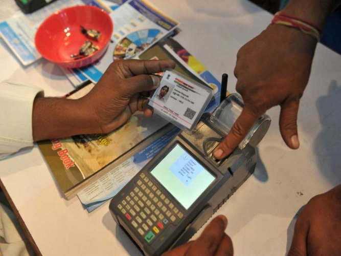 The Supreme Court on Wednesday declared the Aadhaar scheme as constitutionally valid but struck down some of its provisions including its linking with bank accounts, mobile phones and school admissions. (AFP file photo)