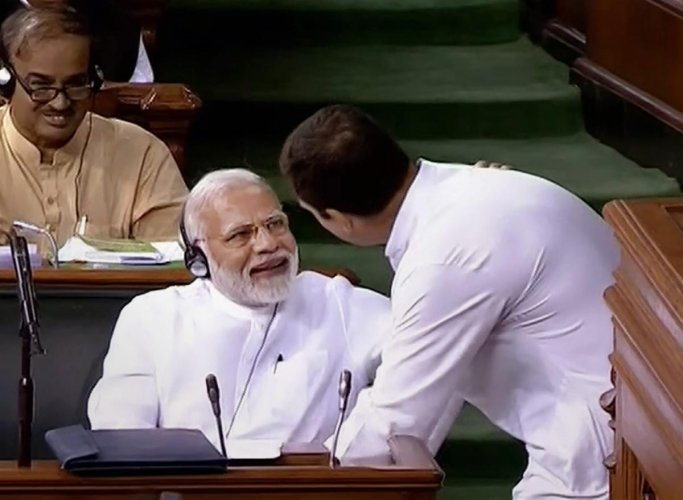 Congress President Rahul Gandhi hugs Prime Minister Narendra Modi after his speech in the Lok Sabha on 'no-confidence motion' during the Monsoon Session of Parliament, in New Delhi on Friday, July 20, 2018. (PTI Photo)