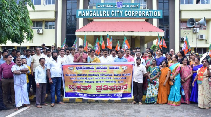 BJP workers and corporators stage a protest in front of Mangaluru City Corporation office on Wednesday.