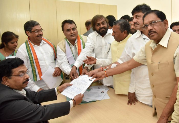 NOMINATION: Congress candidates Naseer Ahmed and M C Venugopal (second and third from left respectively) submit their nominations for bypolls to the Legislative Council, in Bengaluru on Monday. (From right) Deputy Chief Minister G Parameshwara, Minister D