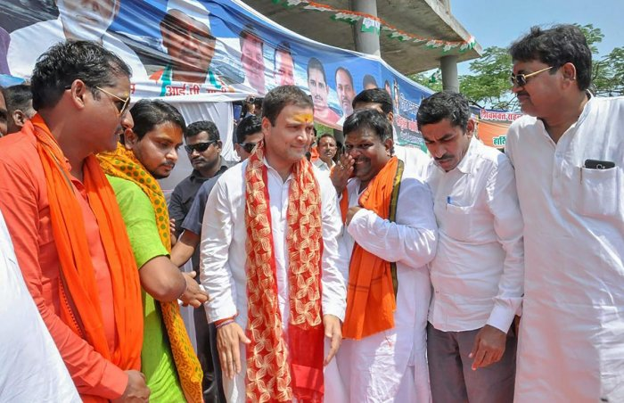 Congress president Rahul Gandhi interacts with a kanwariyas group during a two-day visit to his Parliamentary constituency of Amethi, on Monday. PTI
