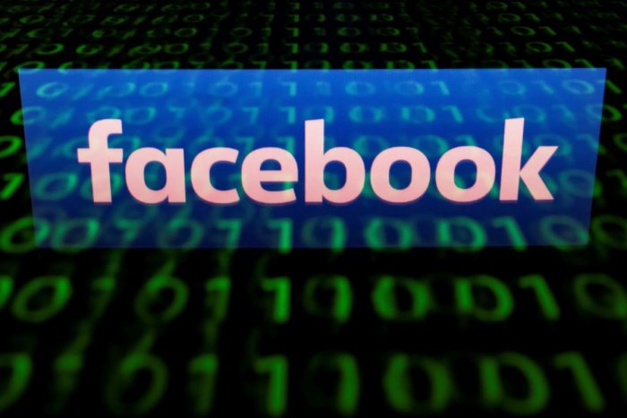 A file illustration picture taken on April 28, 2018 shows the logo of social network Facebook displayed on a screen and reflected on a tablet in Paris. AFP