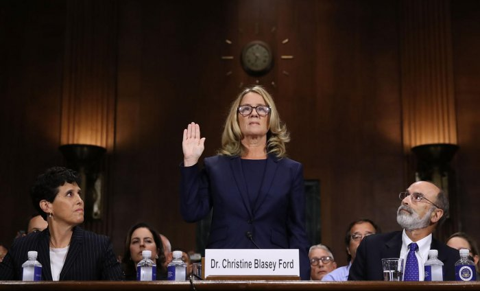 Professor Christine Blasey Ford, the woman accusing Supreme Court nominee Brett Kavanaugh of sexually assaulting her at a party 36 years ago, is sworn in before the US Senate Judiciary Committee on Capitol Hill in Washington, DC, September 27, 2018. AFP