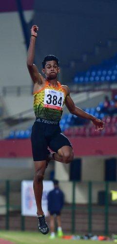 M Sreeshankar leaps to the long jump gold.