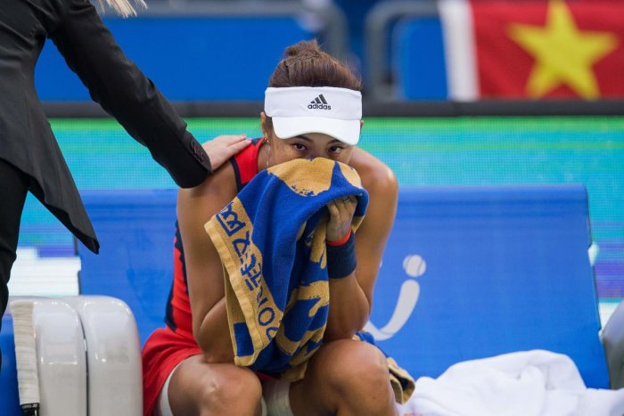 SAD END China's Wang Qiang can't control her tears after being forced to pull out of her home Wuhan Open semifinal against Anett Kontaveit on Friday. AFP