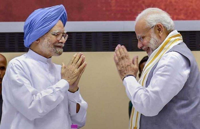 Manmohan Singh and Narendra Modi (PTI File Photo)