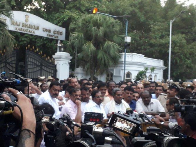 H D Kumaraswamy and Siddaramaiah address the media after meeting Governor Vajubhai Vala at Raj Bhavan in Bengaluru. Photo: Darshan Devaiah.