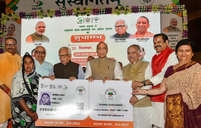 Union Home Minister Rajnath Singh flanked by UP Governor Ram Naik (L) and UP Assembly Speaker Hriday Narayan Dixit at the launch of Ayushman Bharat-National Health Protection Mission (AB-NHPM), in Lucknow. (PTI Photo)